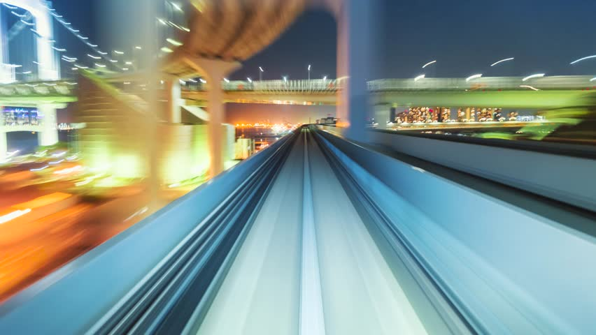 Point of view time-lapse through Tokyo via the automated guideway transit system (AGT) called the Yurikamome. Full ride at night. Shot in 5.7K and down-scaled to 4K for extra sharp resolution. | Shutterstock HD Video #10636388