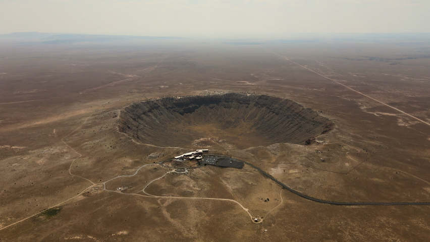 Cinematic aerial flyover of prehistoric impact crater in the Southwest desert | Shutterstock HD Video #1063650841