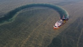 Interesting image created by a fishing ship looking for fish in the blurred sea.