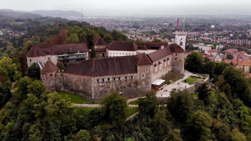 Ljubljana castle is a medieval castle that towers over the old part of Ljubljana. Slovenia, Ljubljana. Royalty-Free Stock Footage #1063659586