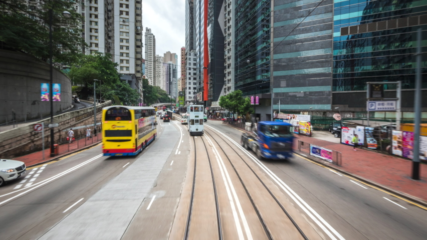 Motion timelapse view of tram ride around central Hong Kong, China, one of the most modern and densely populated cities in the world.  Royalty-Free Stock Footage #1063666999
