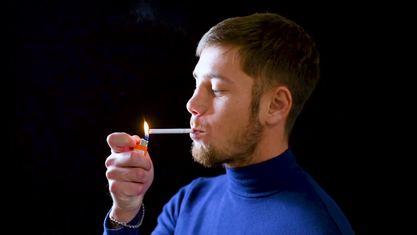 Man smoking cigarette with dreadful grin on his face, planning offence, close-up | Shutterstock HD Video #1063676392