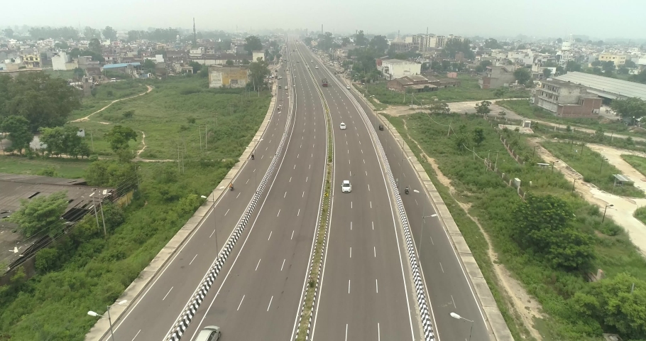 Aerial Drone shot of National Highways in India.Drone shot of Traffic passing on road.Outdoor skyline India.Wide  Establisment shot for countryside.