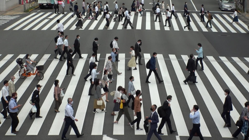TOKYO, JAPAN - NOV 2020 : Aerial high angle view of crowd of people walking at zebra crossing in rush hour. Commuters at the street. Japanese city lifestyle, business and work concept. Slow motion. | Shutterstock HD Video #1063689340
