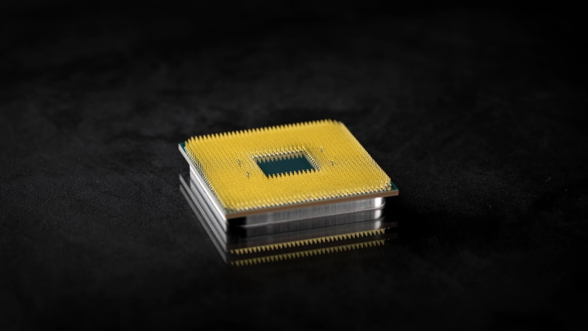 CPU. Studio macro photography of a computer processor. Gold plated contacts are visible in the frame. Royalty-Free Stock Footage #1063699495