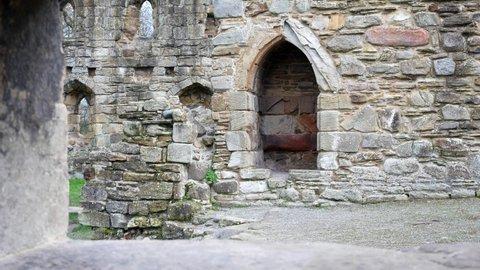 Ancient Basingwerk abbey abandoned historical landmark building stone doorway walls dolly left