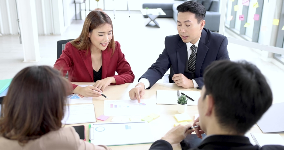 Corporate business team and manager in a meeting, Businessman giving some new ideas about project to his partners in conference room.