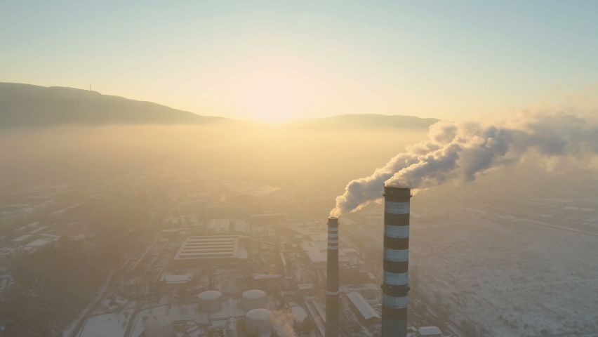 Aerial view of smoking chimney pipes. Air pollution by industrial smoke Royalty-Free Stock Footage #1063717153