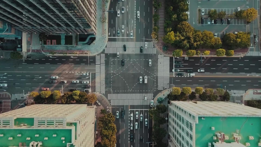 Empty street in Stockholm city, Sweden aerial top down view. Quarantined city, empty abandoned streets during corona virus outbreak. Drone shot flying over buildings, parked cars and street Royalty-Free Stock Footage #1063731643