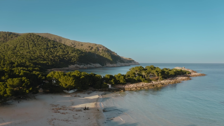 Aerial drone shot in Cala Agulla. Beach in Mallorca, Balearic Island   Shutterstock HD Video #1063734568