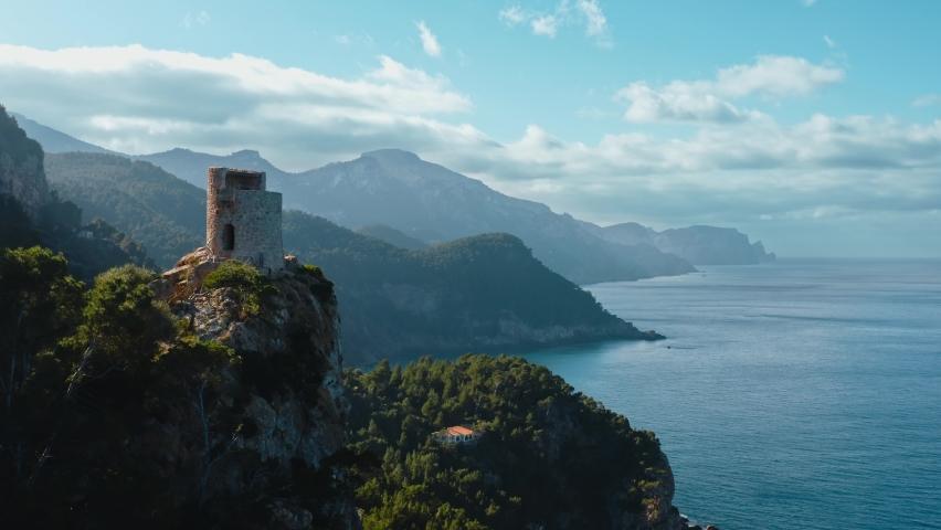 Aerial view of Torre de Verger in Banyalbufar Touristic Town in Mallorca (Majorca) Drone , Es Port des Canonge, Serra de Tramuntana, Spain | Shutterstock HD Video #1063734658