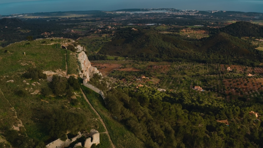 Aerial View of Santueri Castle, Felanitx, Mallorca, Touristic Ruins in the Mountain. Balearic Islands, Spain.   Shutterstock HD Video #1063734709