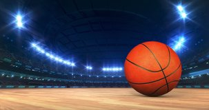 Modern Basketball Arena with shining lights and ball motion on the wooden court. Professional sport 4k video background edited as seamless loop.