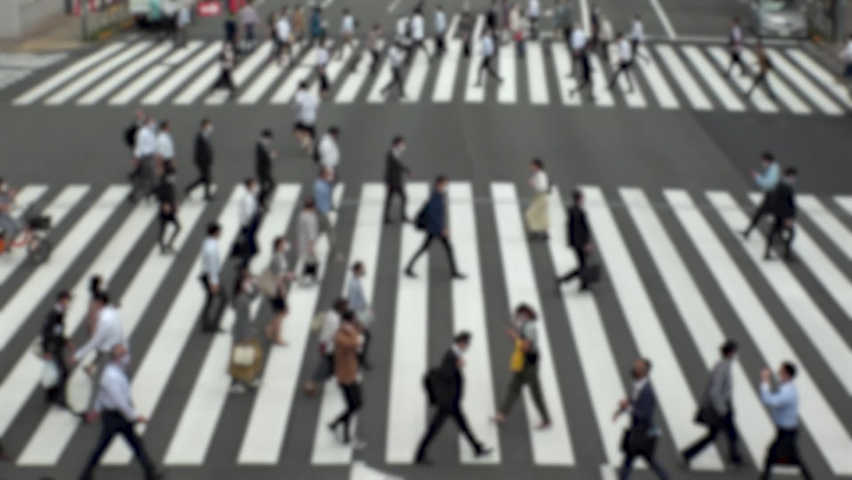 TOKYO, JAPAN : Aerial high angle view of crowd of people walking at zebra crossing in rush hour. Commuters at the street. Japanese city lifestyle, business and work concept. Slow motion blurred shot. | Shutterstock HD Video #1063757695