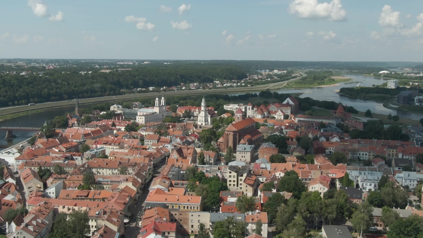 Beautiful skyline of Kaunas city old town with church towers and city hall with Nemunas and Neris rivers confluenceand forest in the background, Aerial drone view. Royalty-Free Stock Footage #1063761481