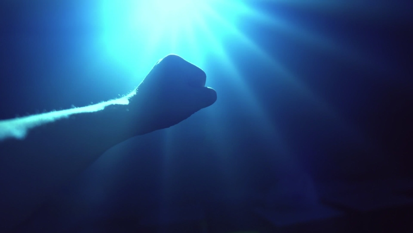 Hand reaching out to cover shinning spot light . Concept of hope and freedom . Royalty-Free Stock Footage #1063766074