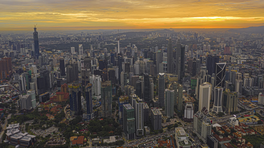 Kuala Lumpur Time Lapse: Sunset of cityscape during a golden sunset overlooking an elevated highway in Kuala Lumpur city. Malaysia. Cinematic. Golden hour. Prores Full HD | Shutterstock HD Video #1063767181