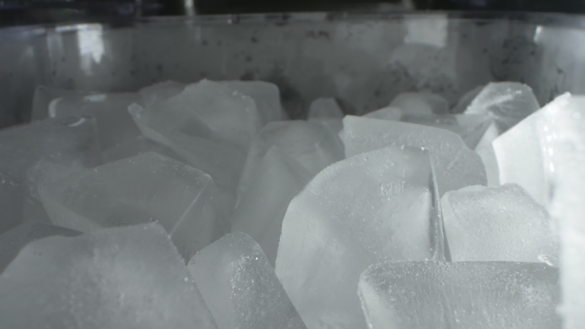 Extremely close-up, detailed. ice cubes in a plastic transparent container.   Shutterstock HD Video #1063767943