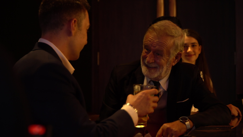 Cheers . senior executive business man and customer toasting with whiskey at bar counter at pub together.  Royalty-Free Stock Footage #1063774375