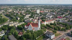 Siauliai, Lithuania. Beautiful panoramic aerial 4K video from flying drone on Siauliai and the city church on a sunny summer day. (series)