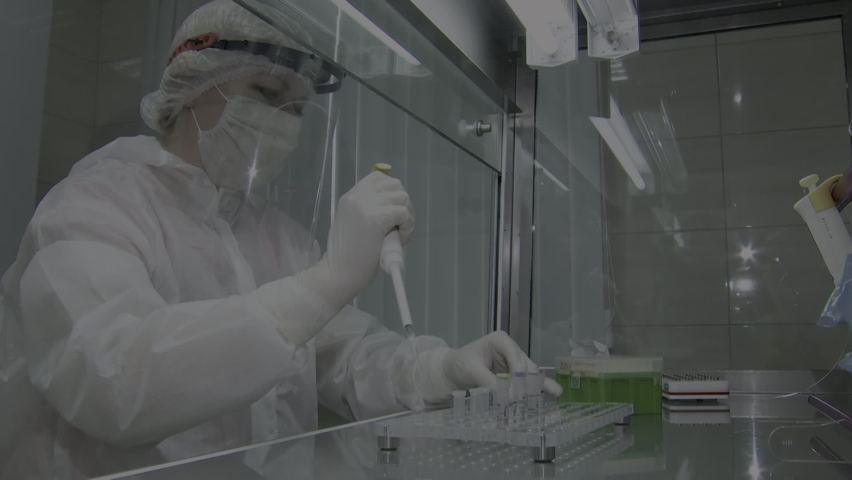 A laboratory assistant performs a test for COVID-19 by polymerase chain reaction. Royalty-Free Stock Footage #1063794946