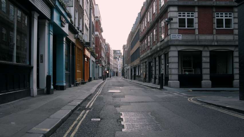Empty street and closed shops  in London during lockdown | Shutterstock HD Video #1063798642