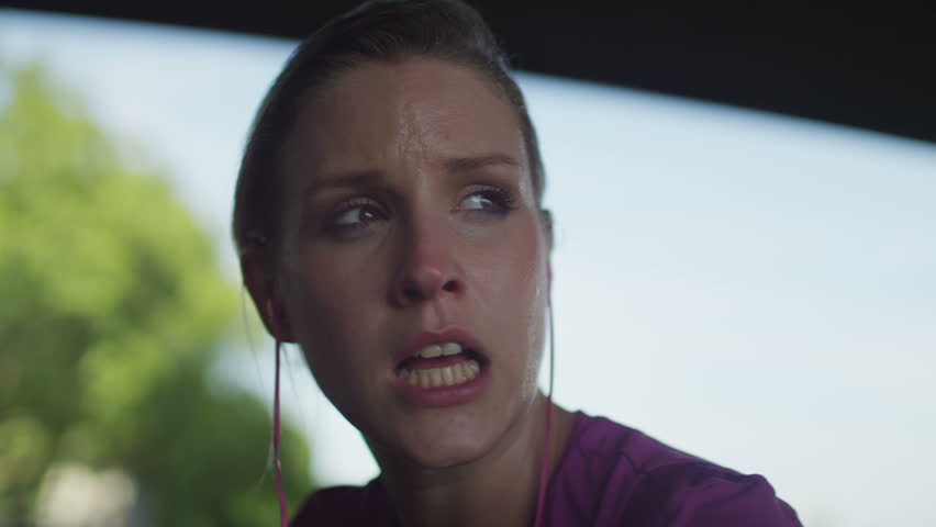 4K Female jogger out of breath looks around with a subtle smile on her face in slow motion, shot on RED EPIC   Shutterstock HD Video #10638107