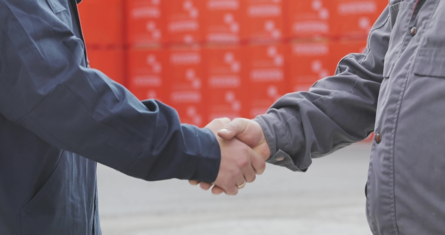 Two men shake hands. Handshake of two men close-up. Factory shaking hands, concluding a successful deal