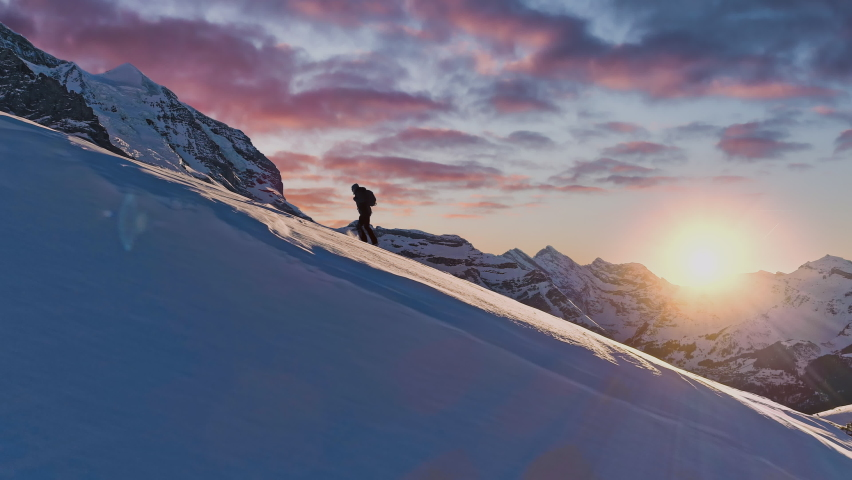 Mountain Expedition Mountaineering Trekking Everest Epic Aerial Of Successful Climber Heading Toward Success Hiking Up To Mountain Top Swiss Alps Vacation Healthy Lifestyle Happiness Achievement Royalty-Free Stock Footage #1063826536