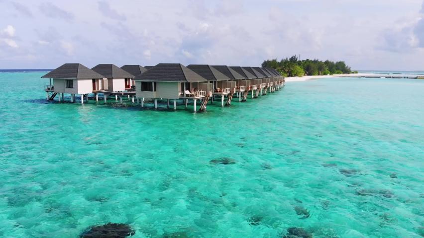 Aerial view of beautiful Maldives island water villa bungalows, Summer Island