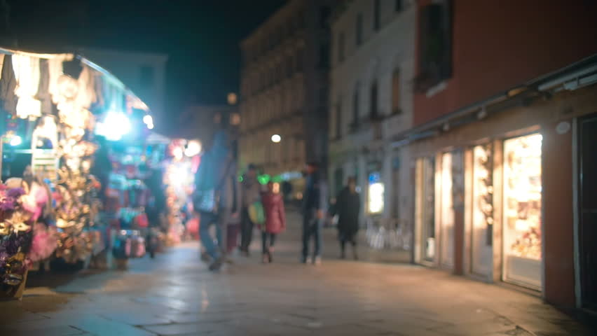 Slow motion steadicam shot of Venetian street in the evening. People walking among shops and counters #10638341