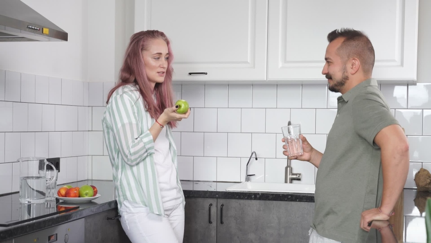 Caucasian married couple have talk in the kitchen, beautiful woman and man have breakfast. #1063872571