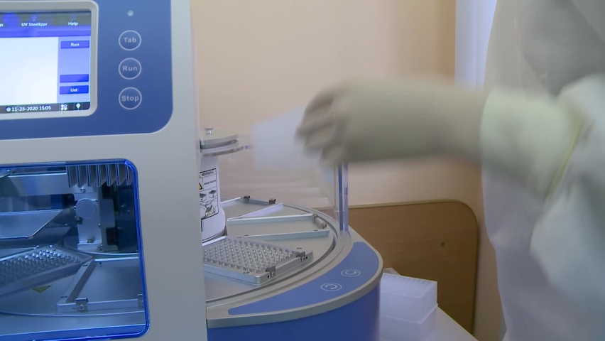 A laboratory assistant performs a test for COVID-19 by polymerase chain reaction. Royalty-Free Stock Footage #1063899487