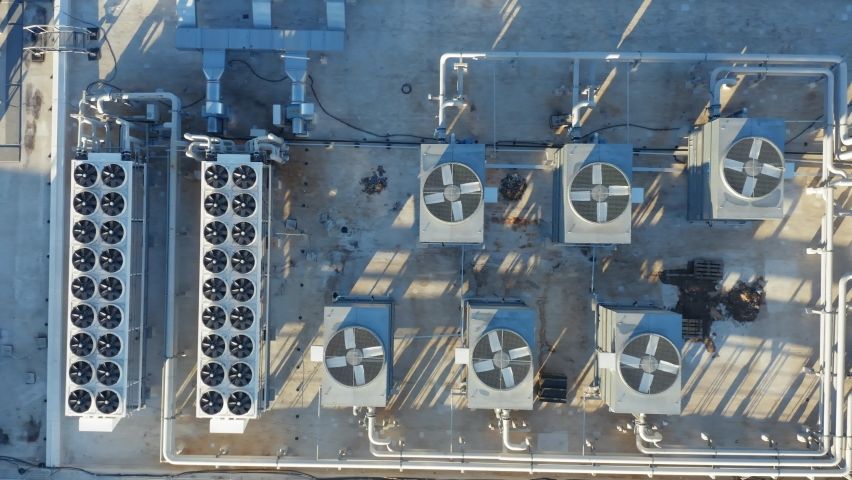 Heating, ventilation and air conditioning systems installed on the rooftop. Aerial top down view Royalty-Free Stock Footage #1063924231