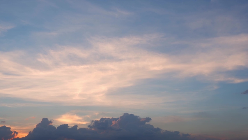 4K Time lapse, beautiful sky with clouds background, Timelapse of skyscrapers, Blue sky with clouds and sun, Clouds At Sunrise. Royalty-Free Stock Footage #1063932088