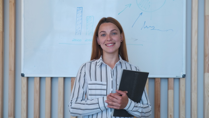 Business woman looking at camera in office