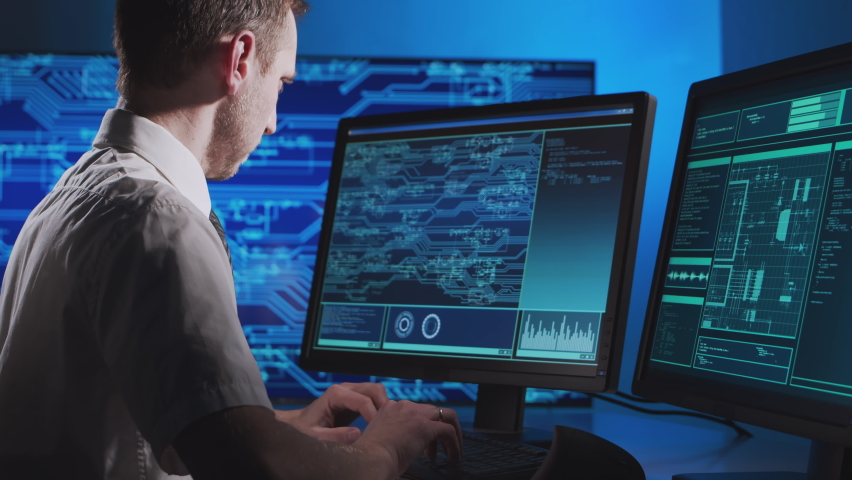 Workplace of an engineer developing a microchip. Professional coder works on modern technologies using a computer. Royalty-Free Stock Footage #1063941307