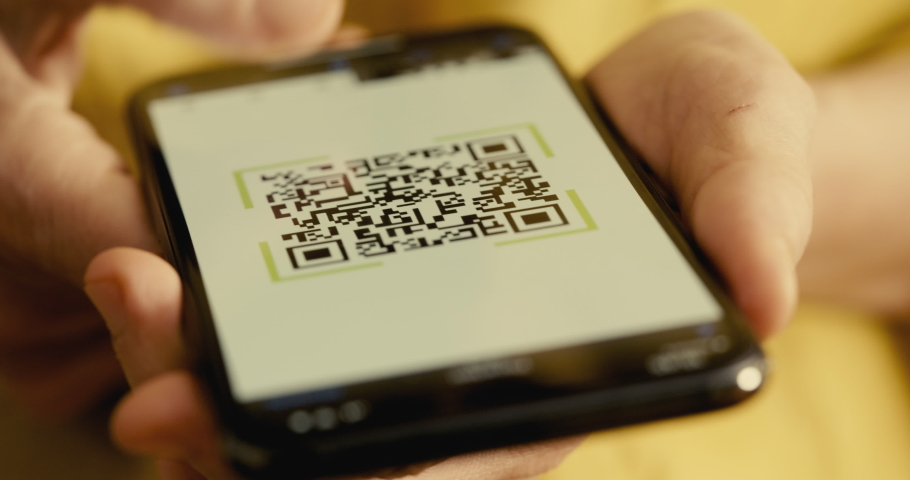 Scanning QR code with mobile phone  Royalty-Free Stock Footage #1063950049