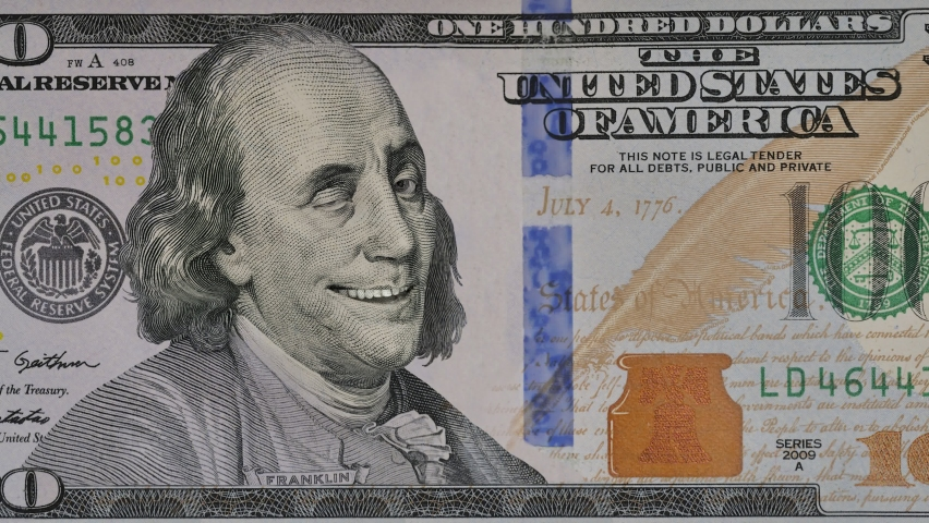 Ben Franklin winks at us from the 100 dollar bill. Funny character animation of the United States money. | Shutterstock HD Video #1063968514