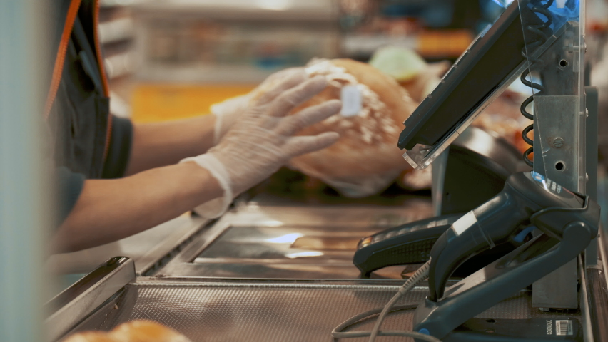 Checkout Counter Hands of the Cashier Scans Groceries, Fruits and other Healthy Food Items. Clean Modern Shopping Mall with Friendly Staff, Small Lines and Happy Customers.  Royalty-Free Stock Footage #1063969096