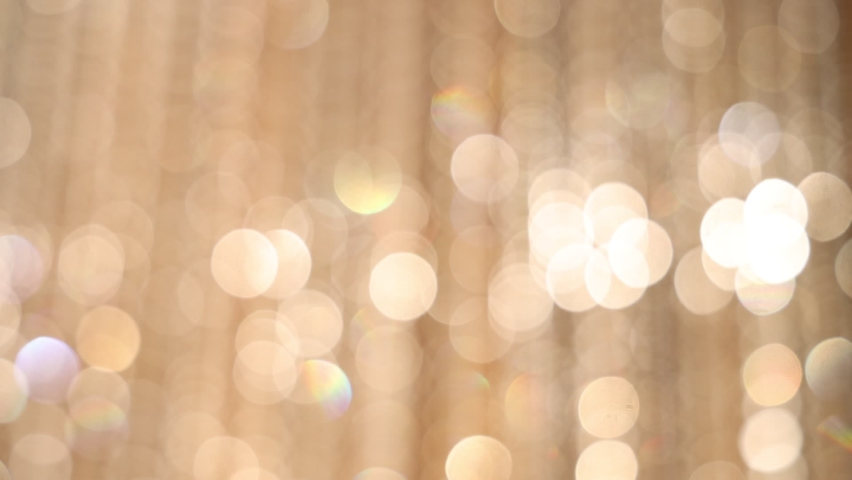 Yellow Soft-Focus Lights Flashing. Lens Bokeh. Focus Flare lights. | Shutterstock HD Video #1063973839