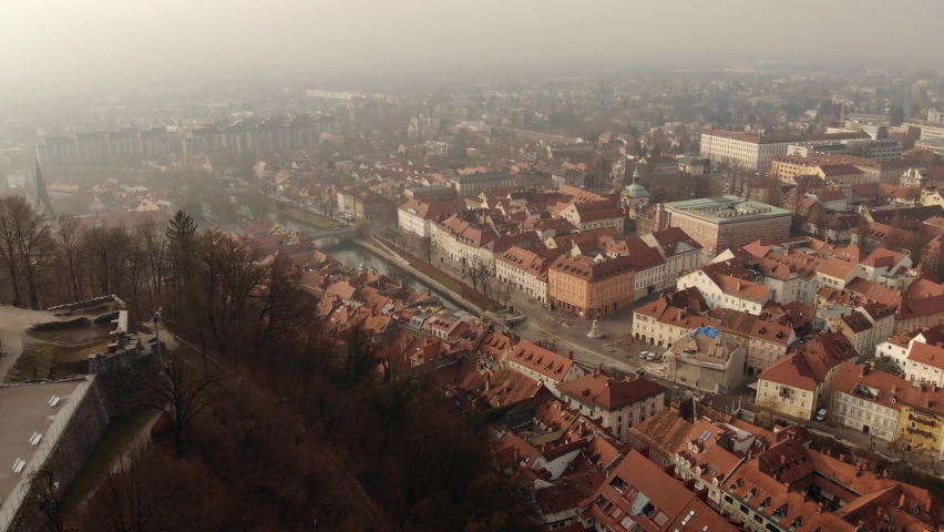 Panorama of the city of Ljubljana and residential areas from the drone. Ljubljanica. River in Slovenia. Dragon Bridge. A pleasure boat sails on the river Royalty-Free Stock Footage #1063976962