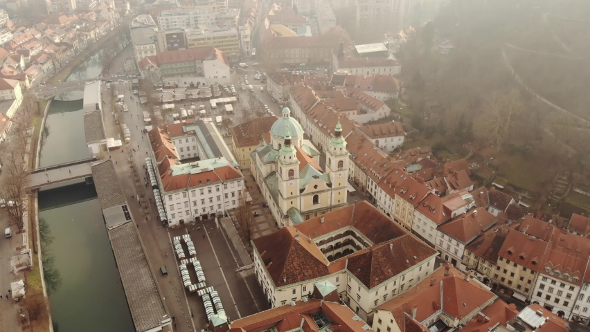 Cathedral of St. Nicholas is a Catholic cathedral in the city of Ljubljana, Slovenia filmed with a drone. Cathedral of the Diocese of Ljubljana, an architectural monument.  Royalty-Free Stock Footage #1063977034