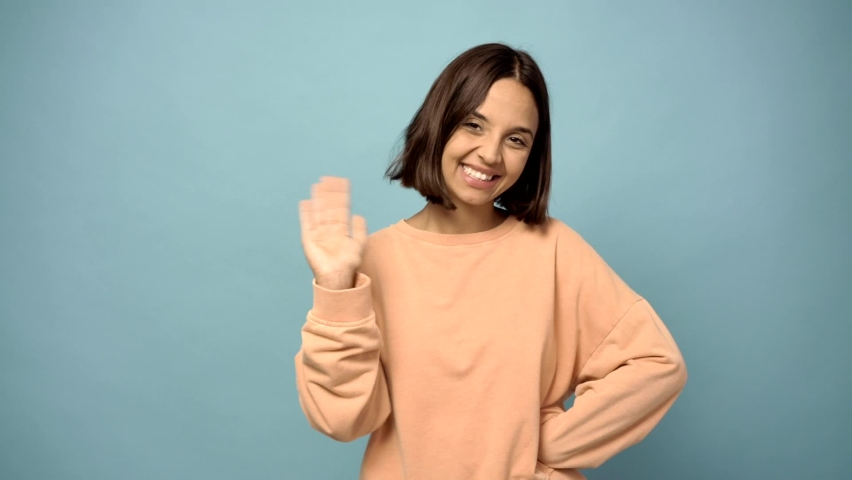 woman saluting with hand with happy expression Royalty-Free Stock Footage #1063981675