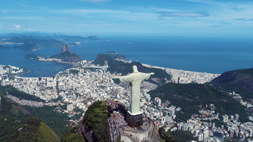 Rio de Janeiro, Brazil. Christ Reedemer. Panorama view of Rio de Janeiro scenery. Christ Redeemer at Sugarloaf Mountain. Rio de Janeiro, Brazil. Summer coastal landscape. Rio de Janeiro skyline city. Royalty-Free Stock Footage #1063986502