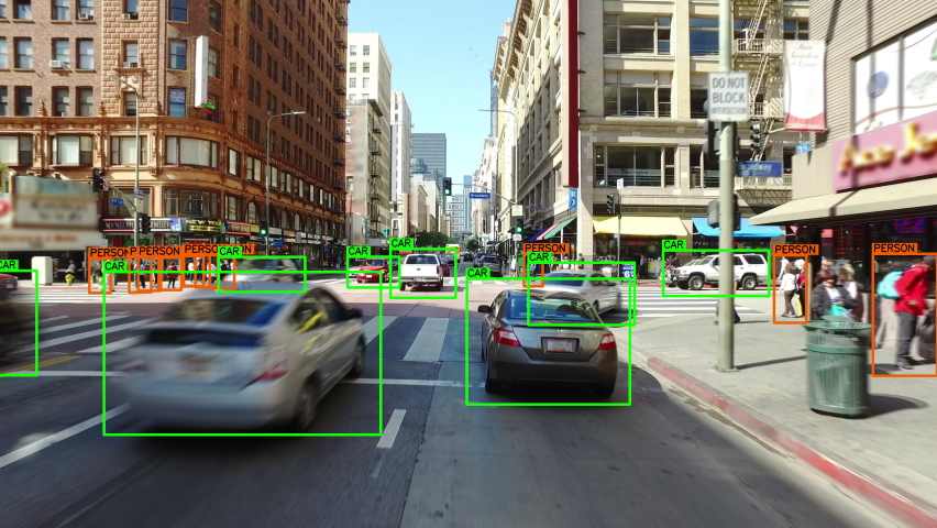 Autonomous or driverless car driving through a crowded street in Los Angeles. Computer vision with object detection system that creates boxes to recognize the different objects in the streets. AI. | Shutterstock HD Video #1064002762
