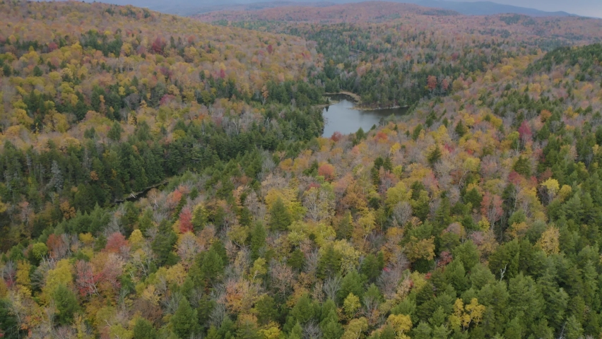 Fall foliage in New Hampshire, New England - 4K Drone aerial view of autumn landscape