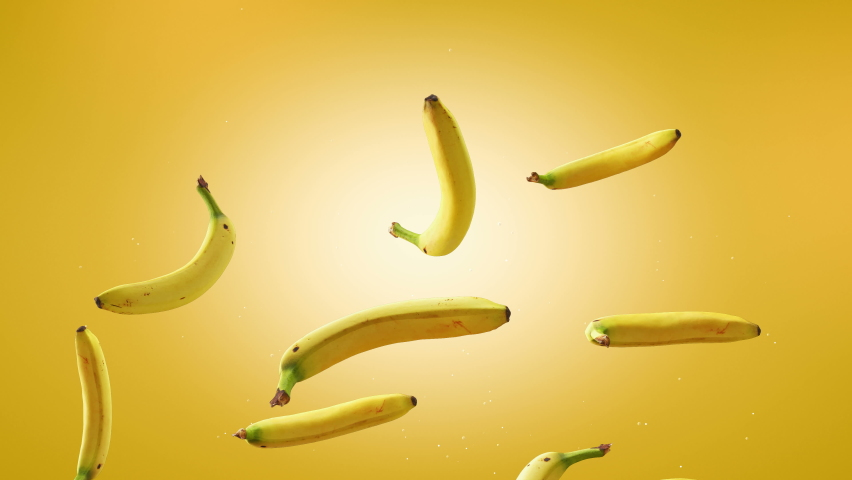 Flying of Bananas in Yellow Background. Speed up and falling down bananas. Two different speed and green screen. Professional slow motion 4K 3d animation. | Shutterstock HD Video #1064012983