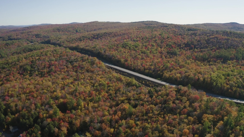Fall foliage landscape in New Hampshire, New England USA during autumn - 4K Drone