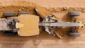 Aerial footage motor grader building resurfacing. Urbanisation and rural roads.